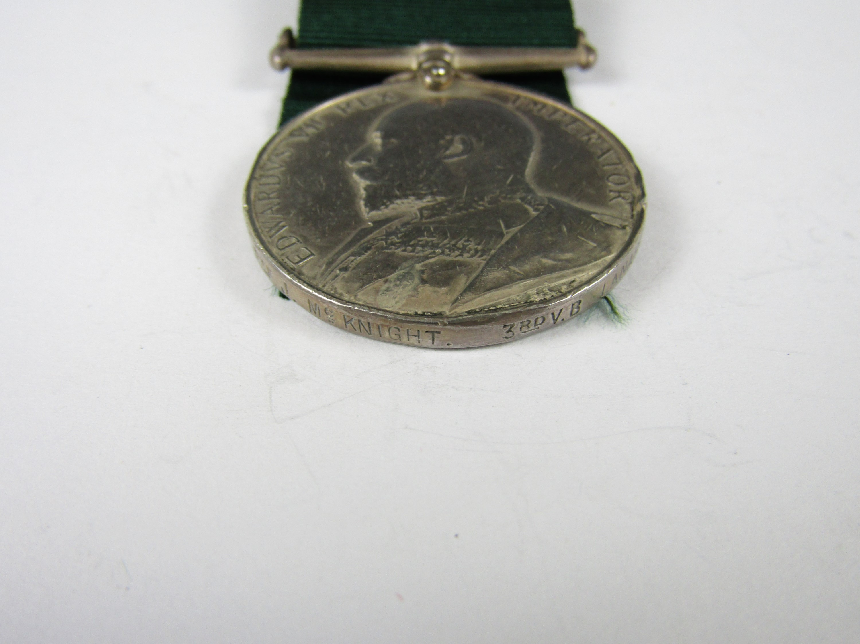 Lot 57 - An Edwardian Volunteer Long Service medal to 7824 Pte J McKnight, 3rd V B Lanark V R C
