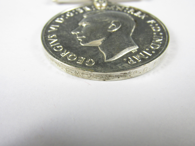 Lot 4 - A George VI Naval Long Service Medal to KX 78750 W C Medland, S P O (TY) HMS Bradford