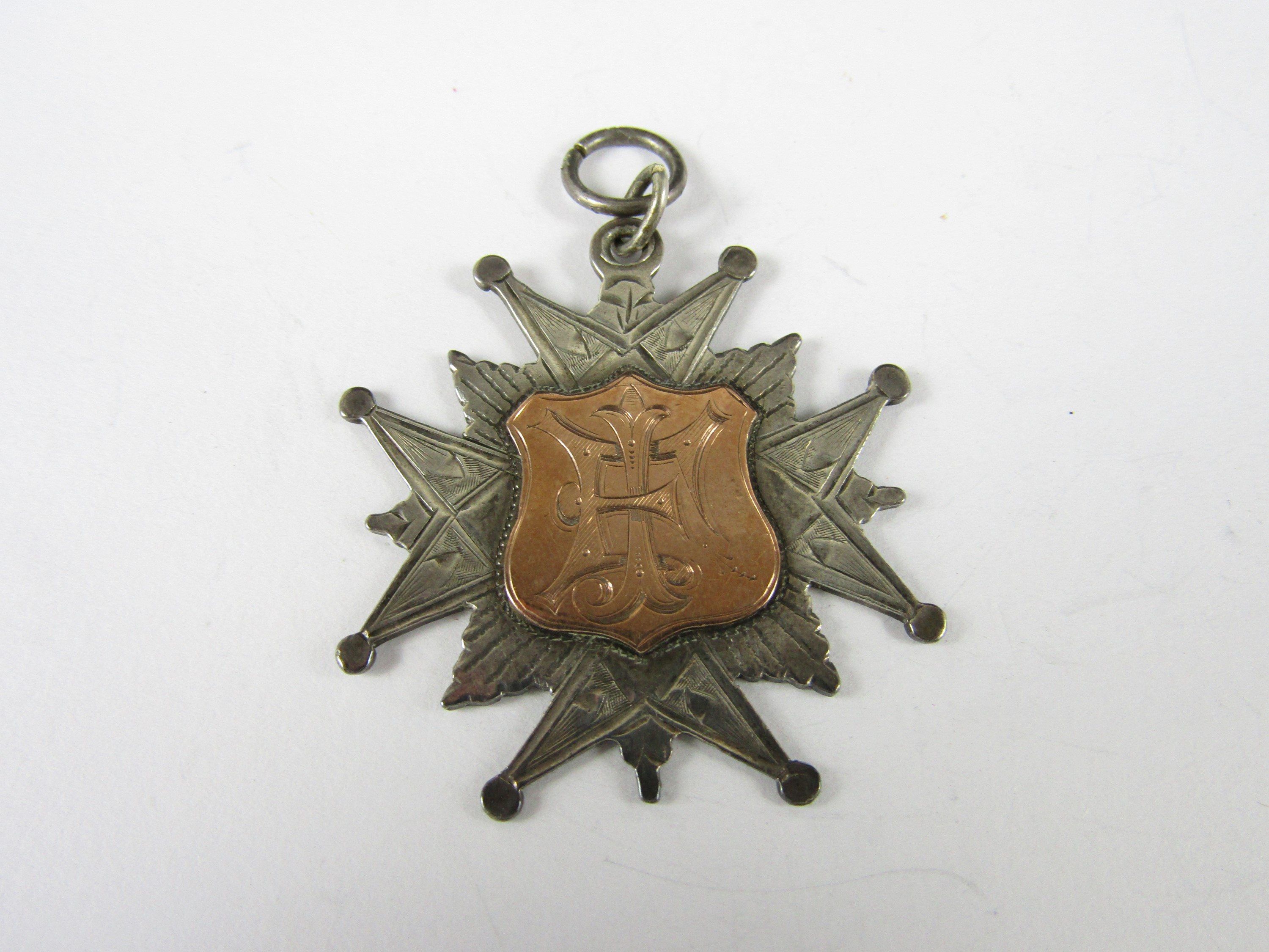 Lot 47 - A Victorian silver prize fob medallion, ECVA, No 5 Coy, Monthly Medal won by Corporal Fraser, 1894