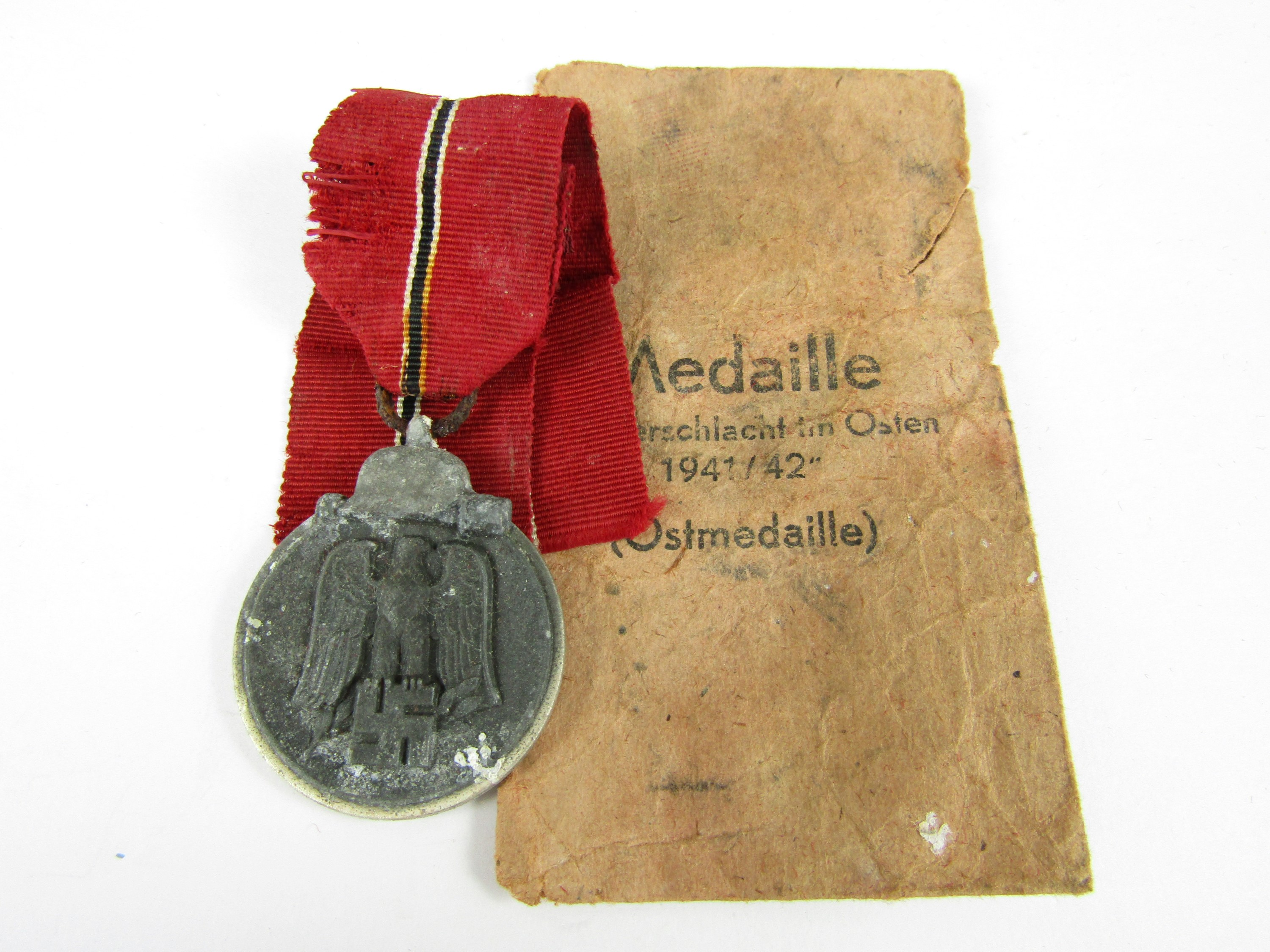 Lot 22 - A German Third Reich Eastern Front Medal and envelope