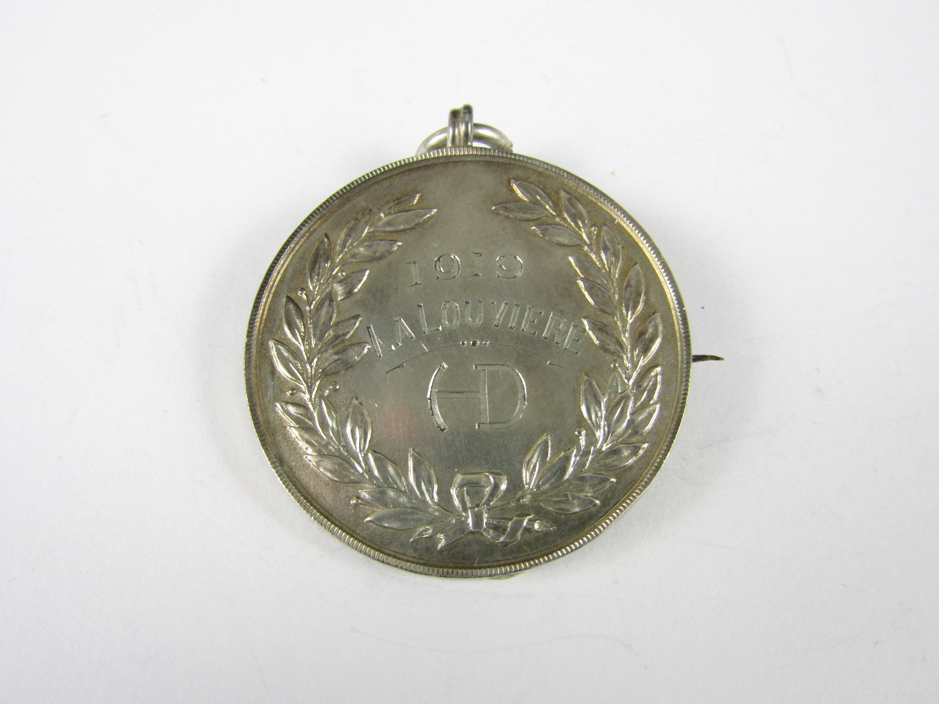 Lot 46 - A 1919 Highland Division silver prize medallion awarded to the Drummer A Galloway, 7th Argyll and