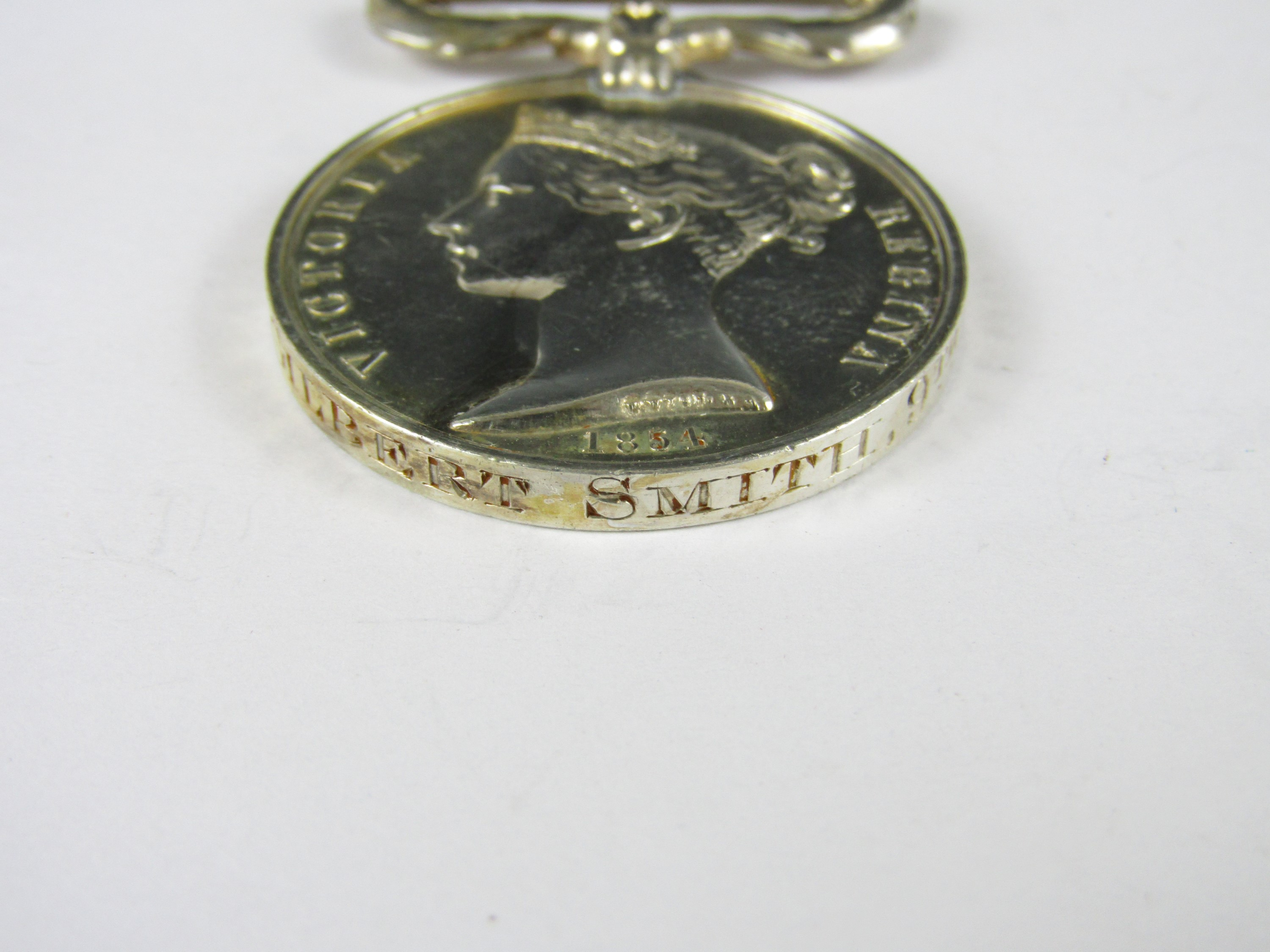 Lot 17 - A Crimea Medal with loose Sebastopol clasp engraved to PRIE Gilbert Smith, 9th Foot