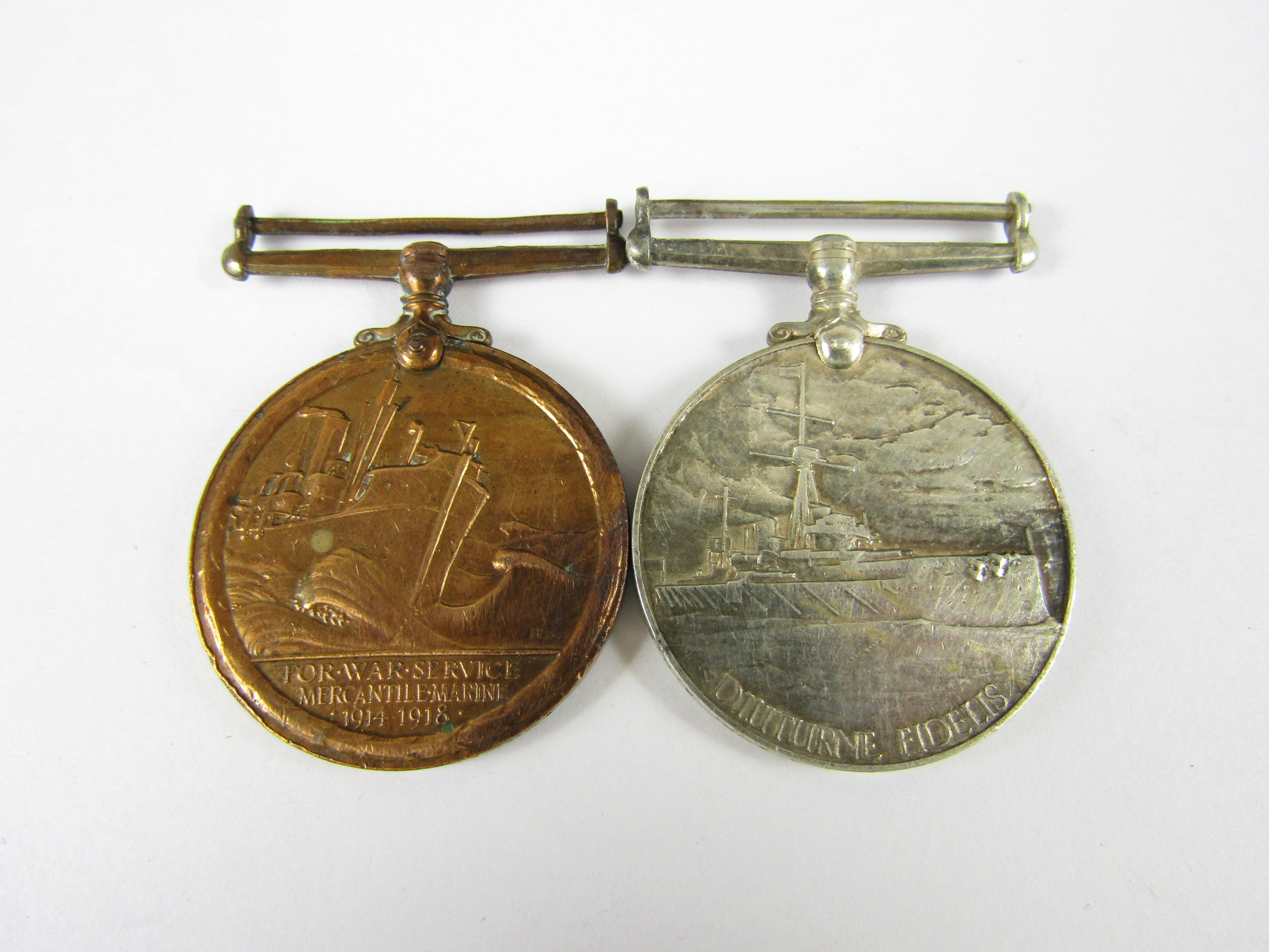 Lot 3 - A George VI Naval Reserve Long Service Medal and Mercantile Marine Medal pair to 5883 D Thomas F
