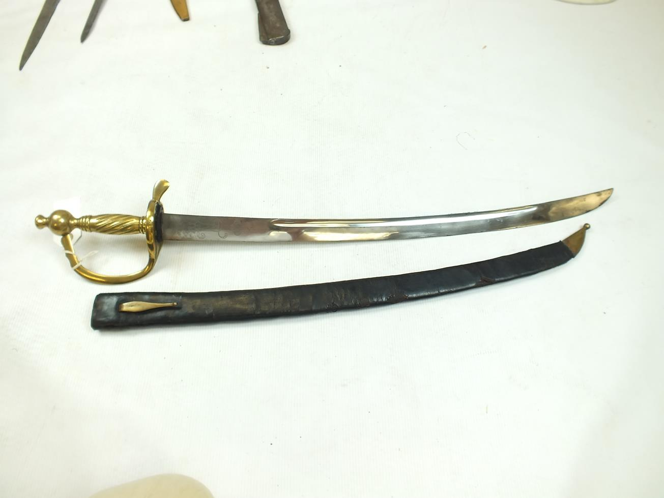 Lot 50 - A PRUSSIAN INFANTRY HANGER CIRCA 1750, 64cm curved fullered blade etched with the crowned Royal