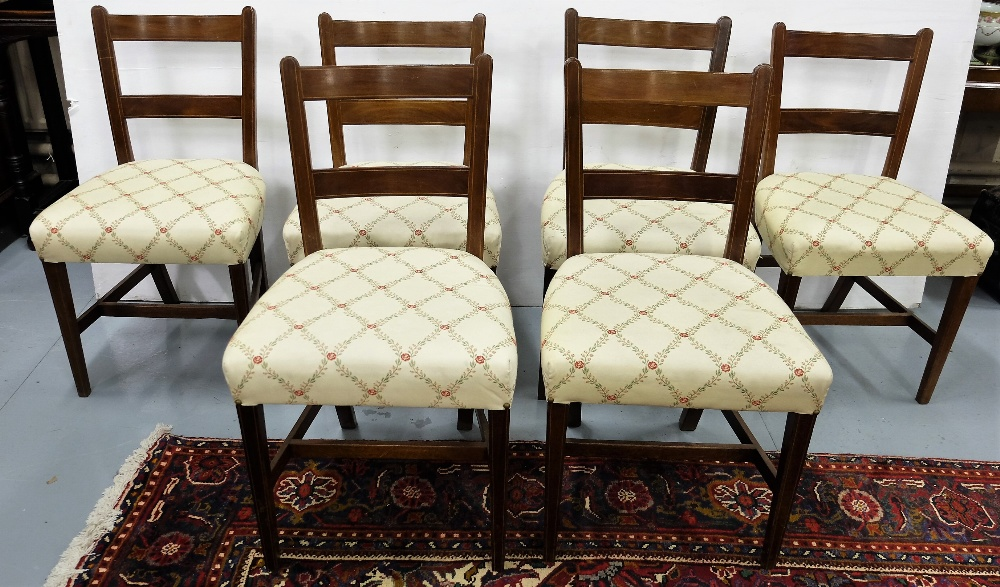 Lot 21 - 6 similar Edwardian dining chairs, padded seats covered with cream ground and rosettes, tapered legs
