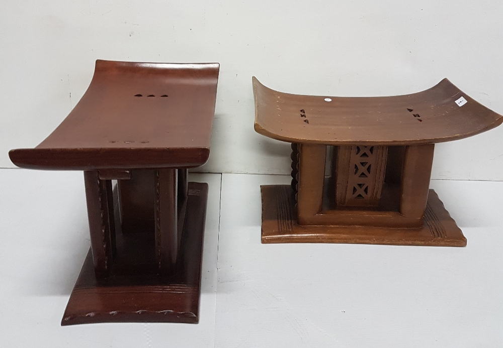 Lot 7 - Matching Pair of African Stools, the low-sized curved seats over decorative internal fretwork,