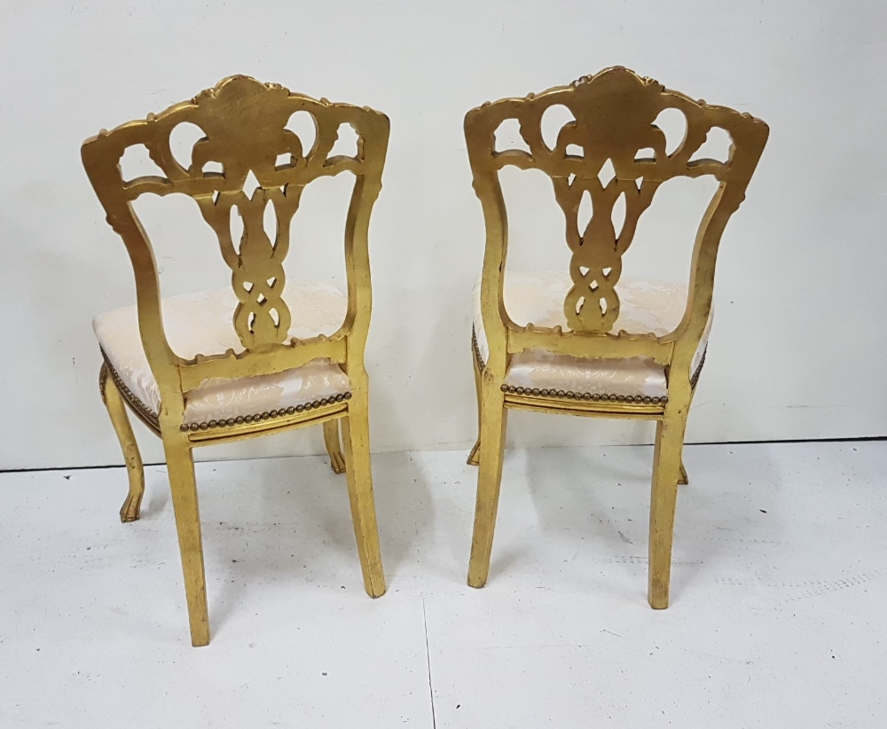 Lot 28 - Matching Pair of Ornate Gilt Salon Chairs, decorative splat backs, over beige upholstered seats,