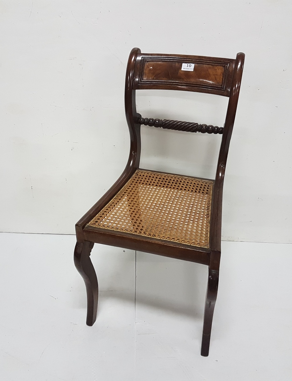 Lot 10 - Regency Mahogany Dining Chair, polished, the curved and scrolled back atop a bergere seat and
