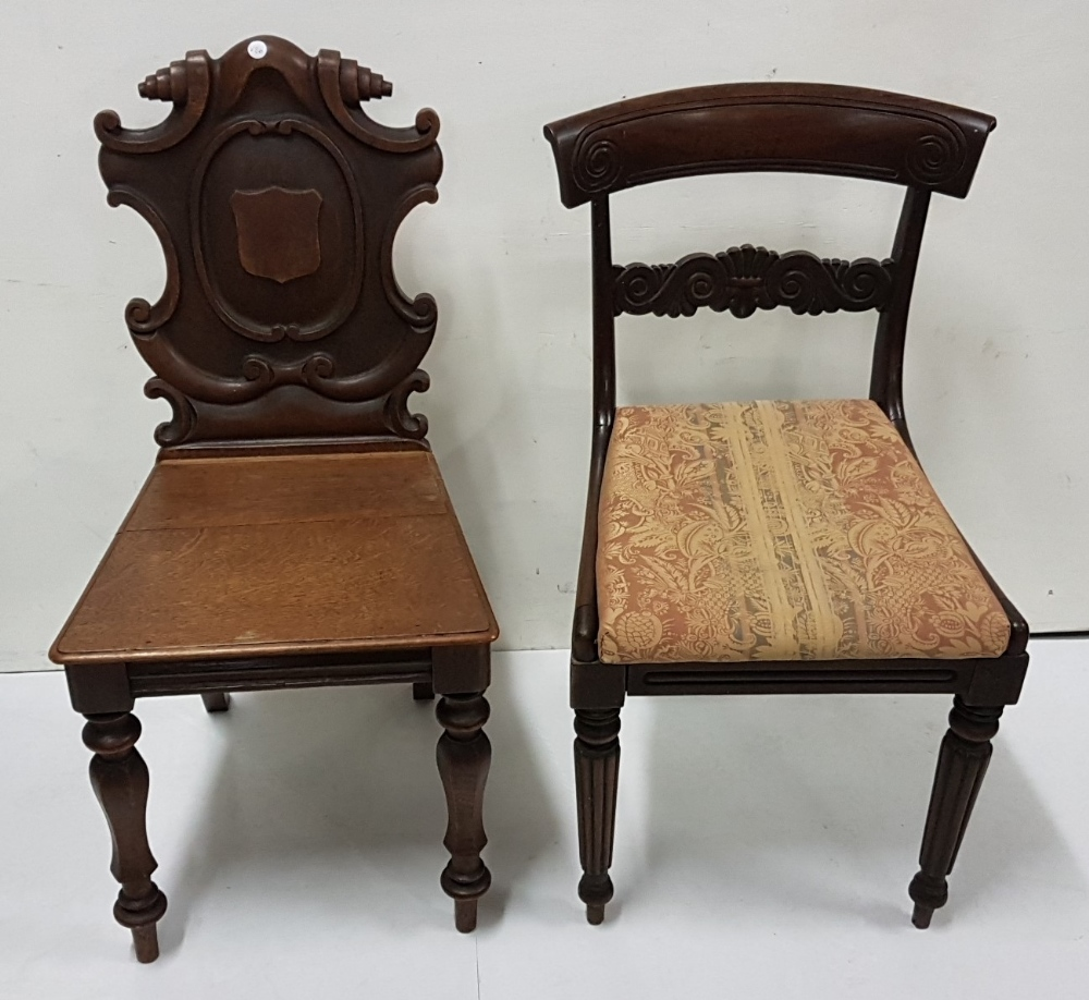 Lot 12 - 19th C oak hall chair with armorial shaped back and a William IV mahogany dining chair (2)