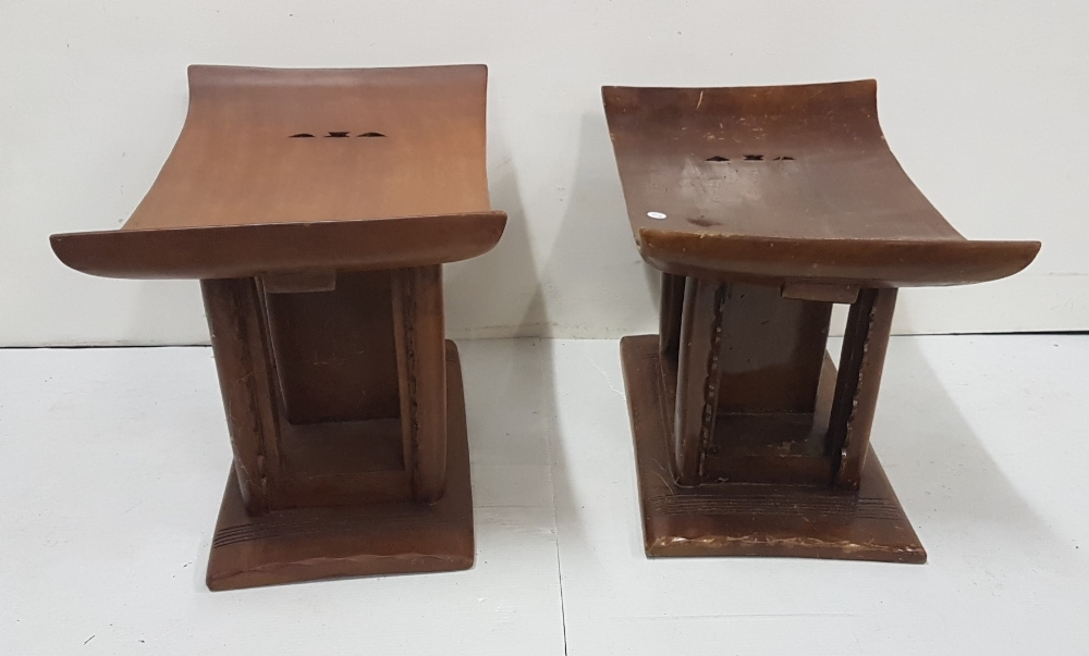 Lot 6 - Matching Pair of African Stools, the low-sized curved seats over decorative internal fretwork,
