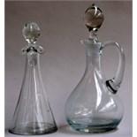 A conical handblown glass vinegar bottle, and a small glass oil jug,