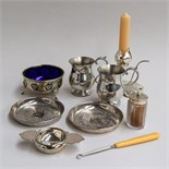 Two small pewter tankards, two small trays with foliate decoration,
