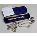 A large silver knife and fork made by George Angell in 1854-5, in blue velvet lined case,
