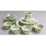 A Crown Staffordshire 'Green Dragon' part tea set, highlighted in gilt, consisting of 8 saucers,