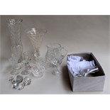 A selection of glass items including six champagne flutes, two cut glass vases, a cut glass jug,