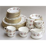 A large quantity of Minton 'Spring Bouquet' pattern fine bone china, highlighted in gilt,
