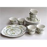 A Royal Doulton Tonkin part tea service comprising a set of six tea plates,