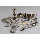 A mixed lot of silver items; three napkin rings, a candlestick, a sugar spoon with pierced handle,