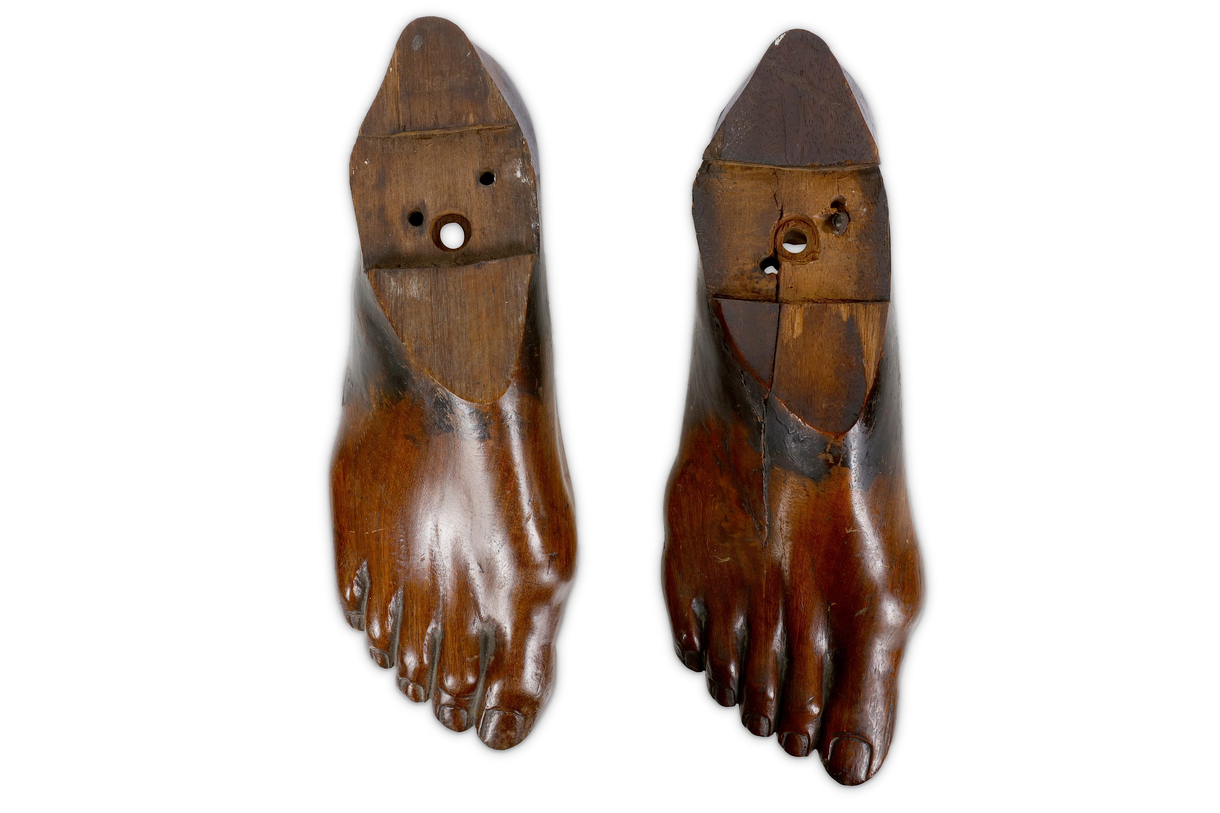 TREEN: A PAIR OF 19TH CENTURY CARVED FRUITWOOD RIGHT FEET - Image 2 of 2
