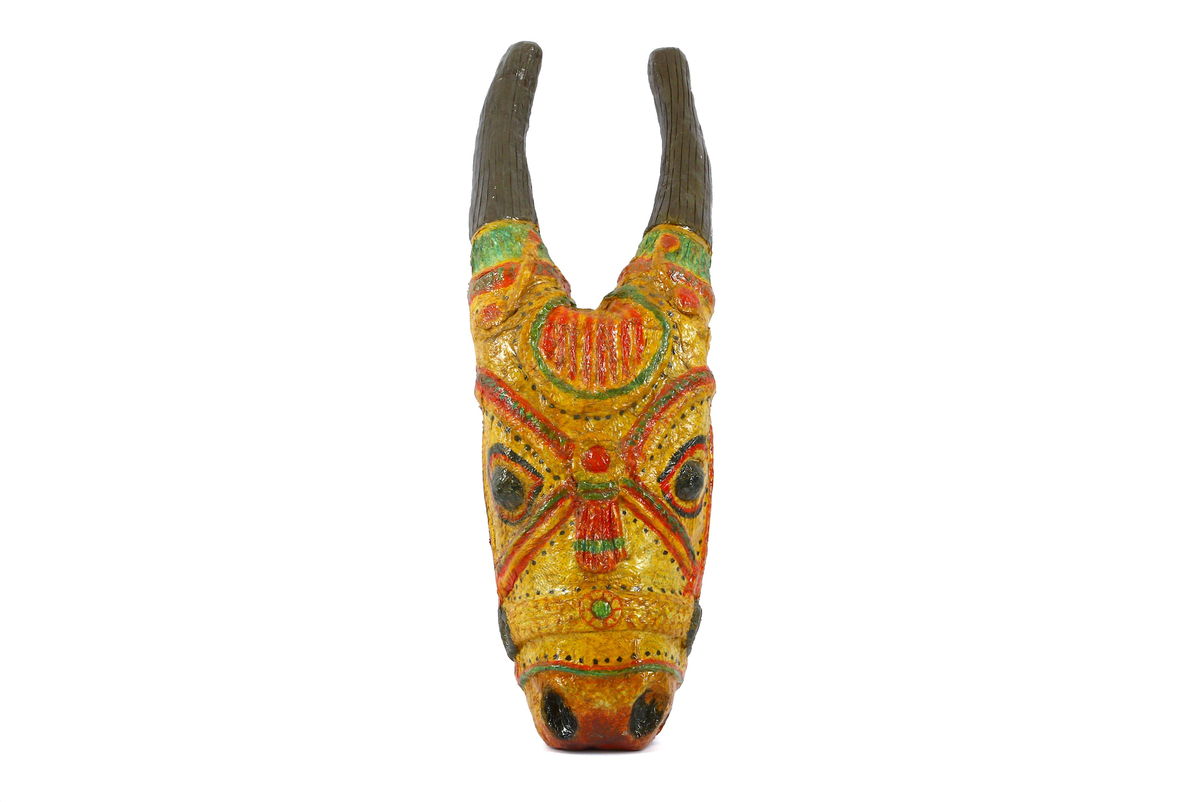 A WALL HANGING DEPICTING THE HINDU GOD NANDI (SHIVA) IN THE FORM OF A BULL