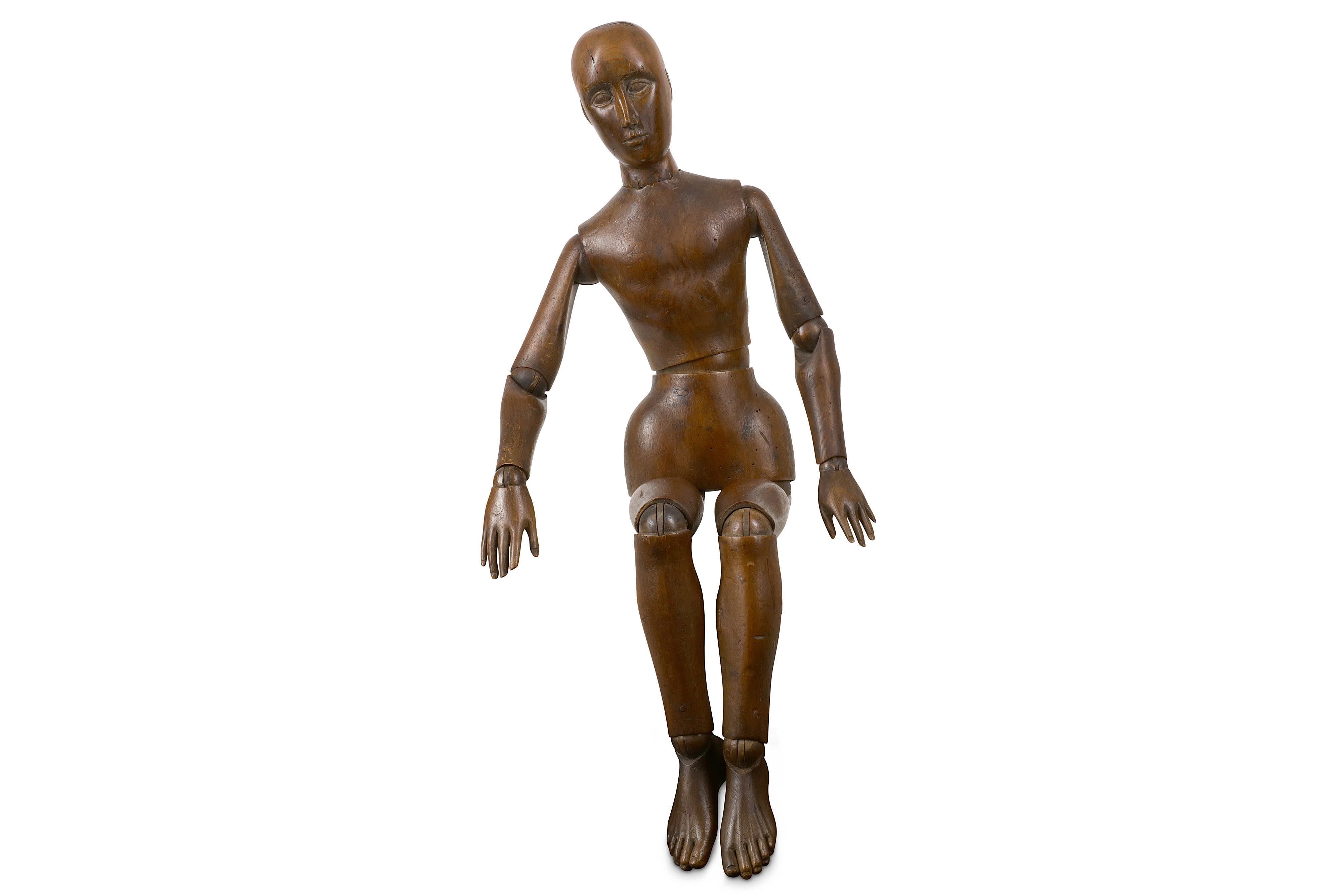AN EARLY 20TH CENTURY CARVED AND STAINED WOOD LAY FIGURE OR ARTIST'S MANNEQUIN