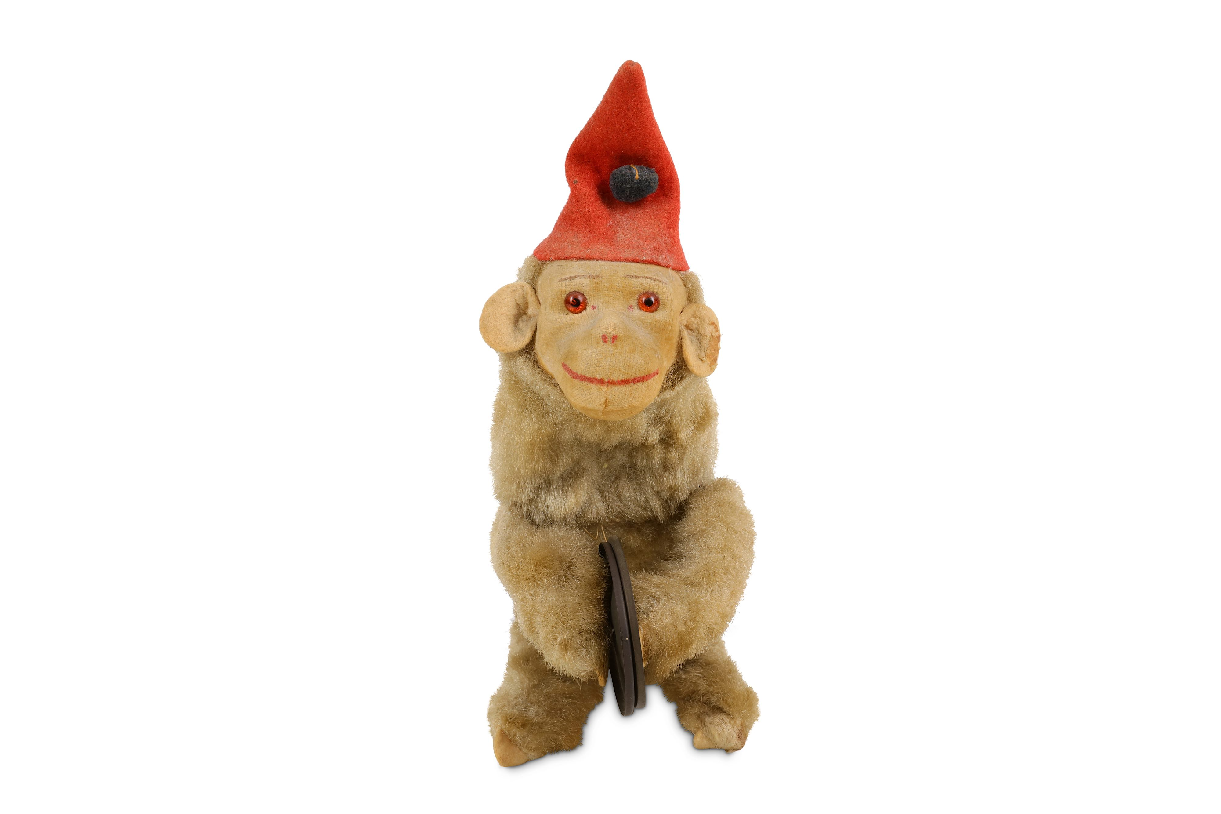 Lot 49 - AN EARLY 20th CENTURY CLOCKWORK MUSICAL JOLLY CHIMP PLAYNG THE CYMBALS