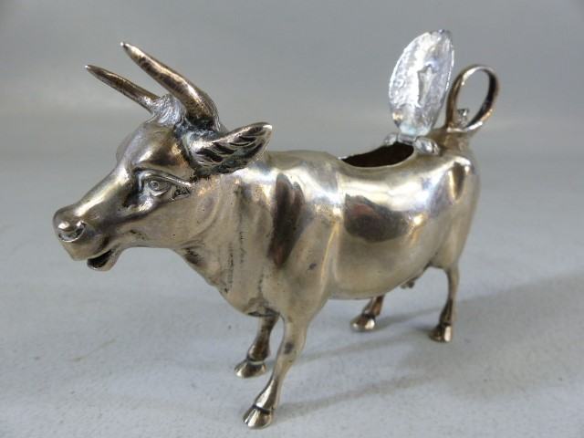 Silver Continental hallmarked 'Cow' creamer. Marked 800 to belly. The hinged lid with floral motif - Image 3 of 7