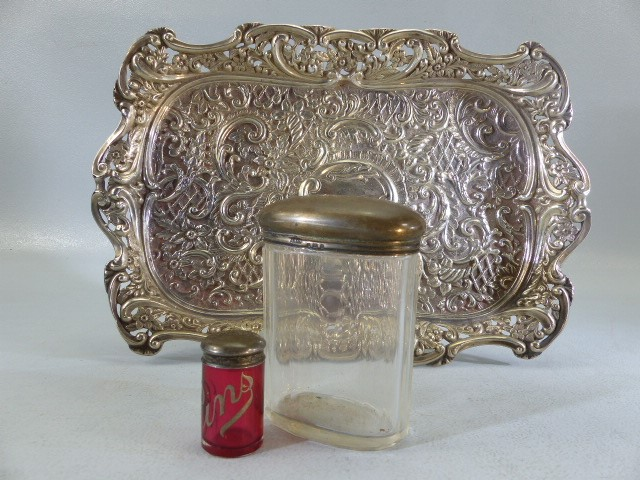 Silver coloured Repousse style tray with hallmarked silver topped bottles one clear one red labelled