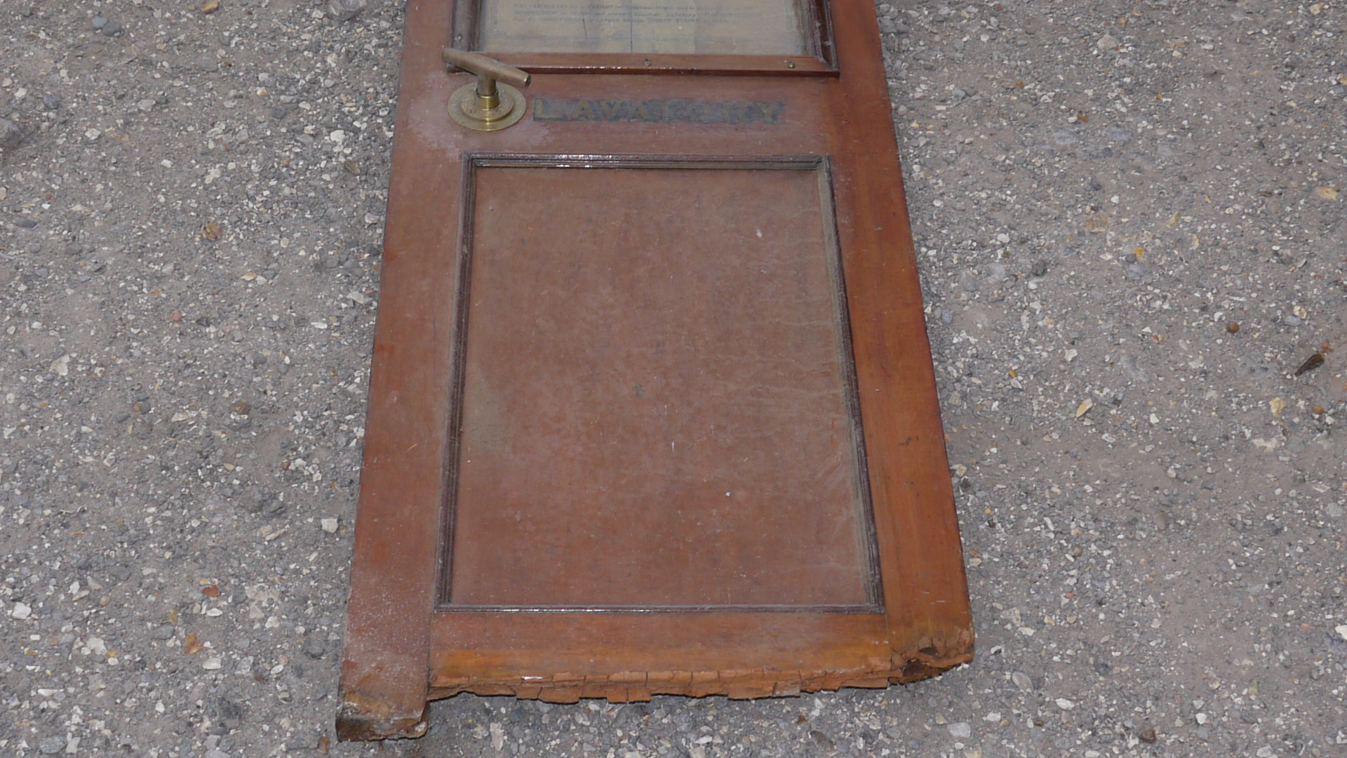 Lot 769 - An Edwardian Railway Carriage Lavatory Door, teak door with upper glazed panel inset with poster