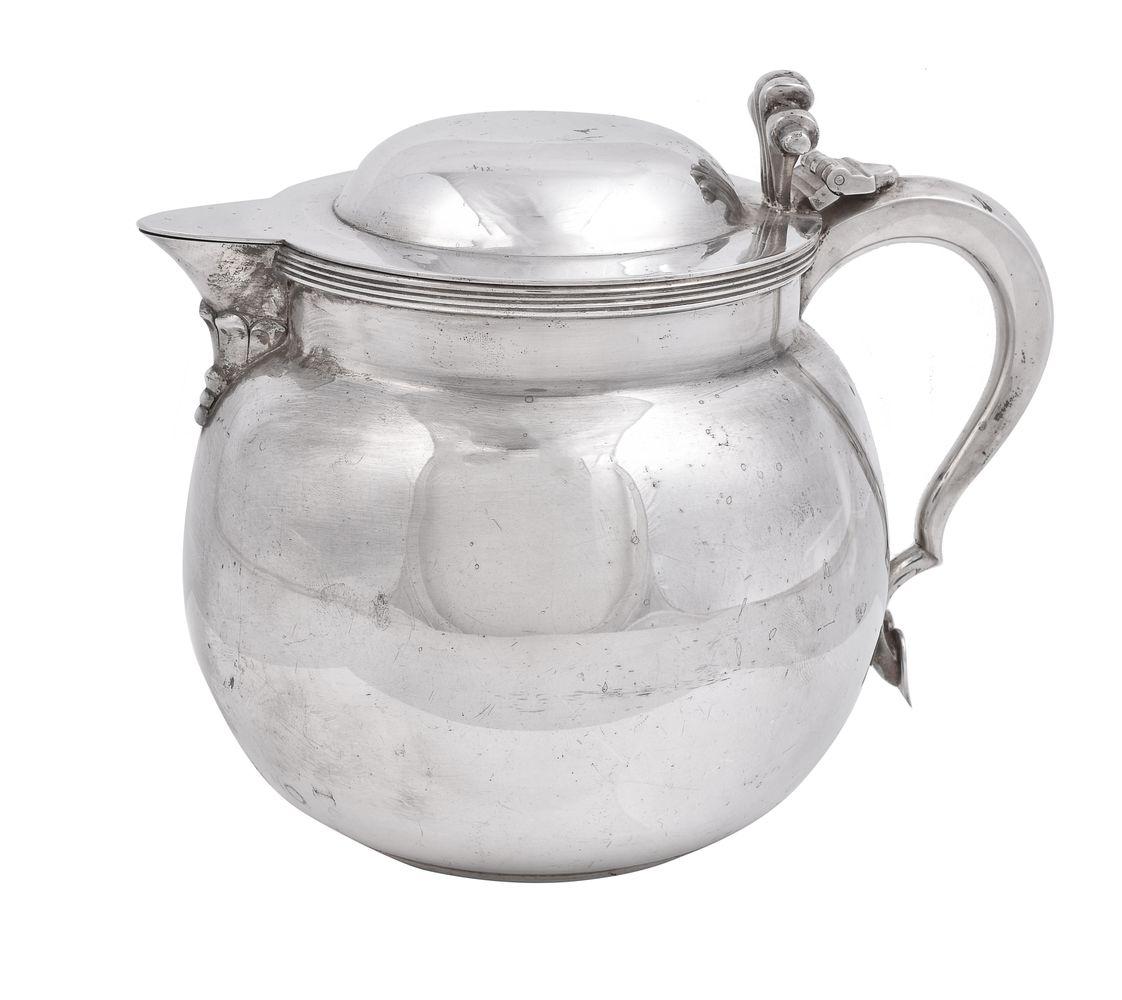 A silver ovoid jug by Edward Barnard & Sons Ltd