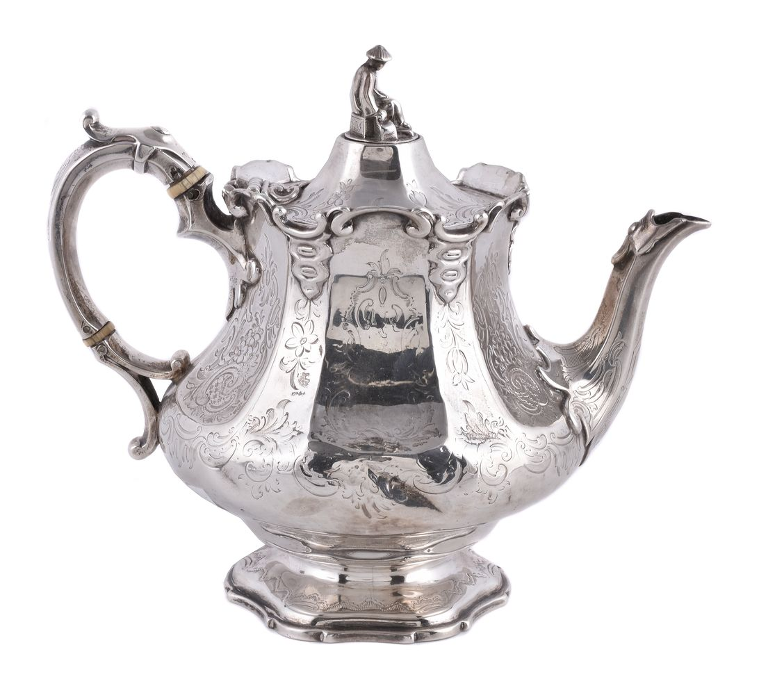 ϒ A Victorian silver panelled baluster tea pot by the Barnard Bros