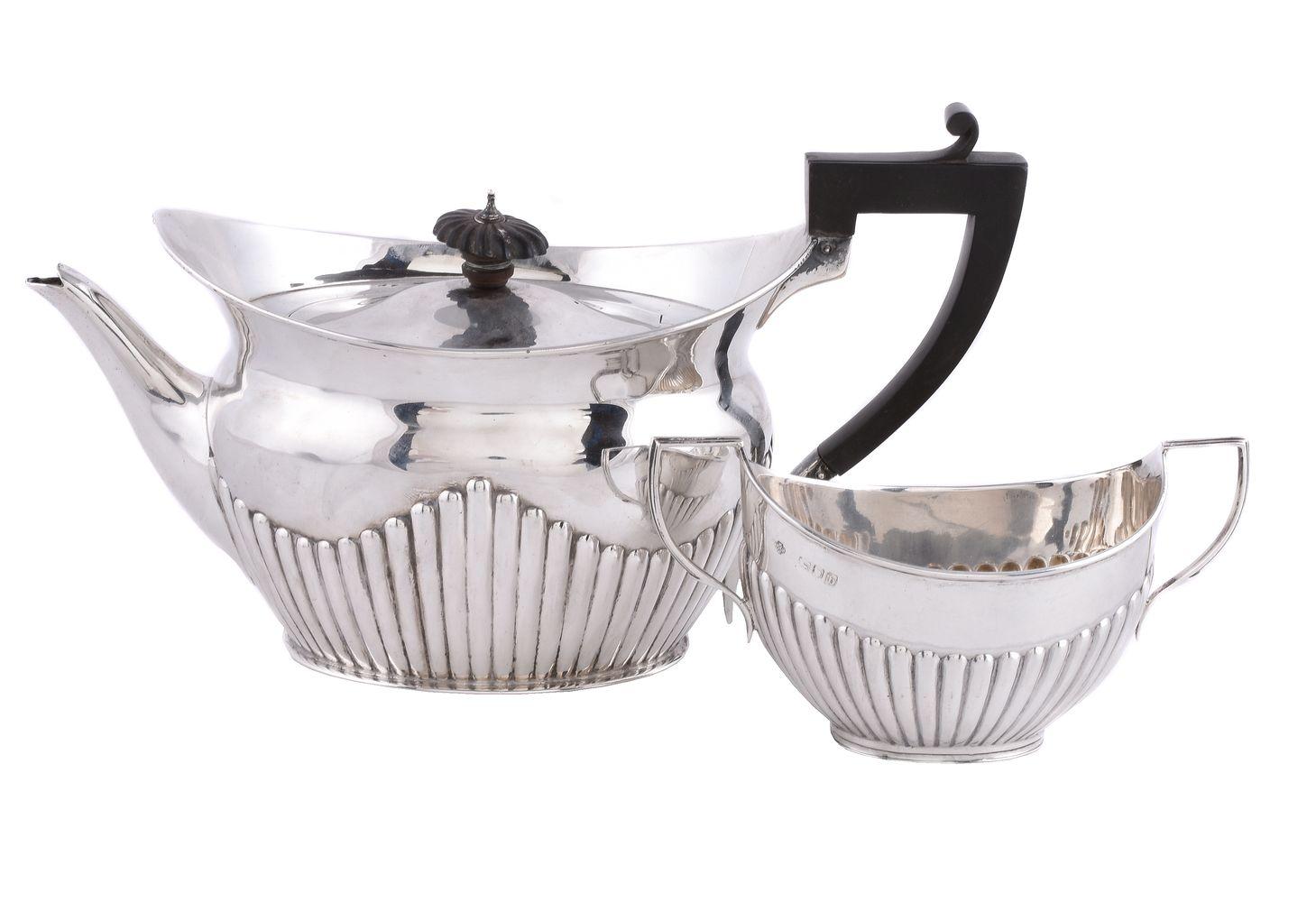 A late Victorian silver navette shape tea pot by The Goldsmiths & Silversmiths Co. Ltd