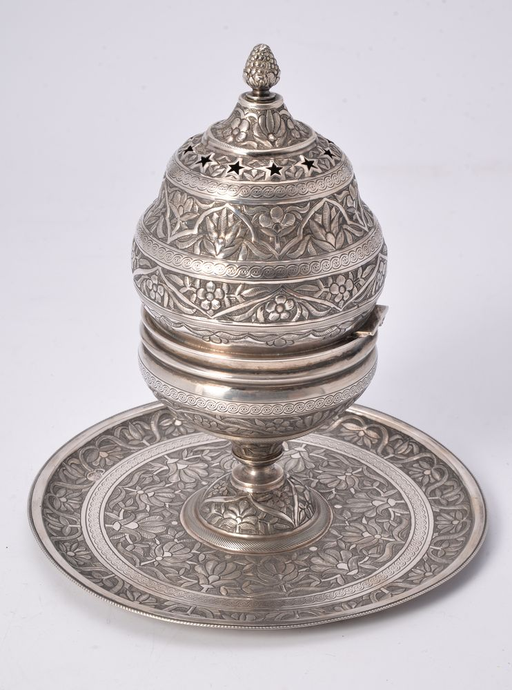 An Egyptian silver coloured incense burner on integral stand (buhurdan)