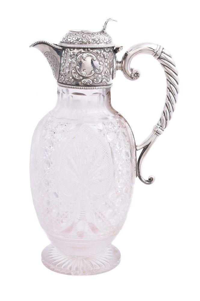 An Edwardian silver mounted cut glass claret jug by W. & C. Sissons