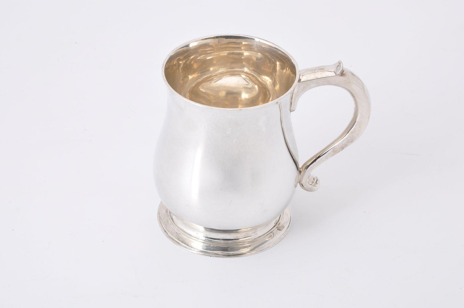 A silver baluster mug by Thomas of New Bond Street