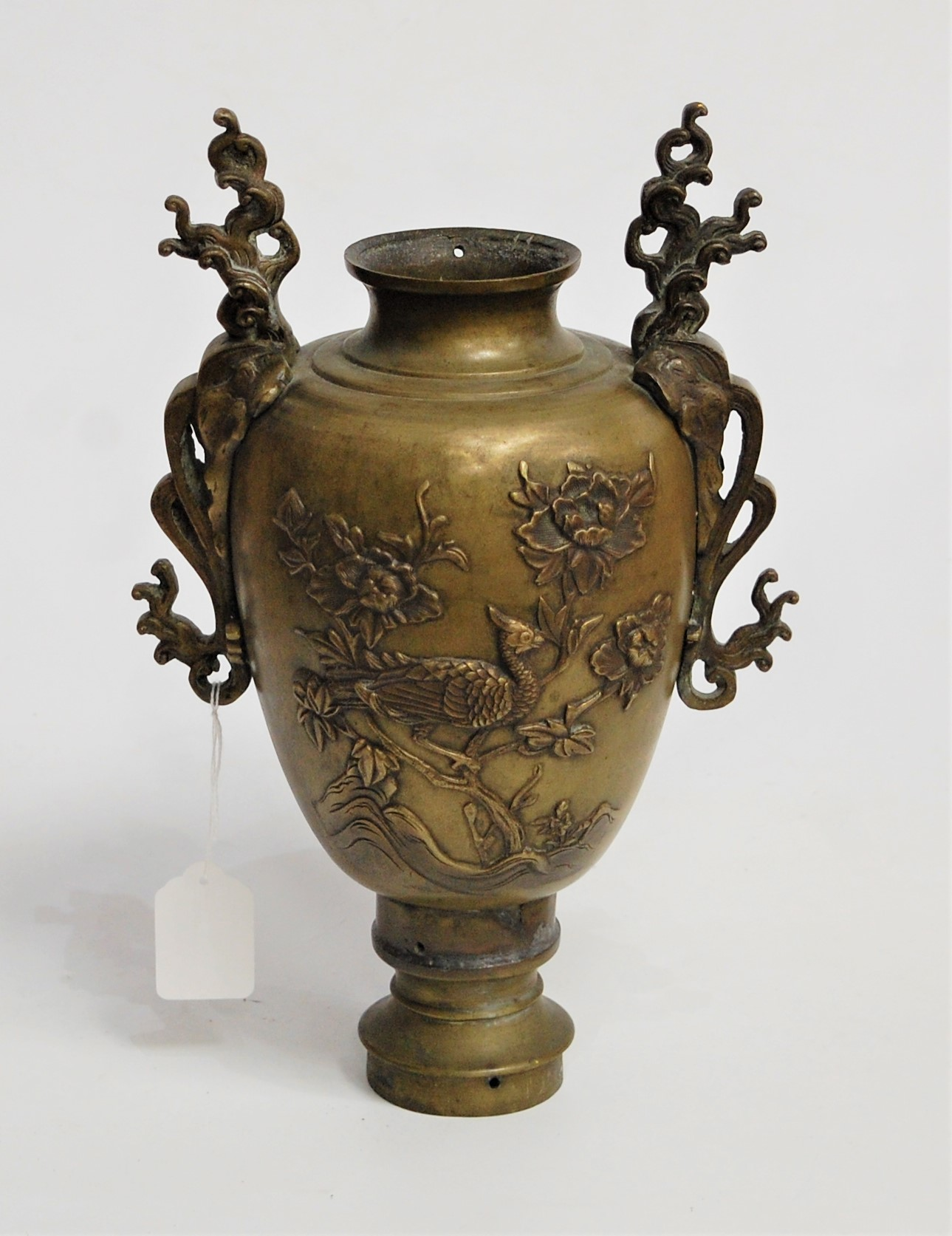 Lot 8 - A Japanese bronze twin handled vase, of baluster form, relief decorated to each side with bird of