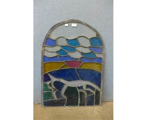 An arched stained glass window pane