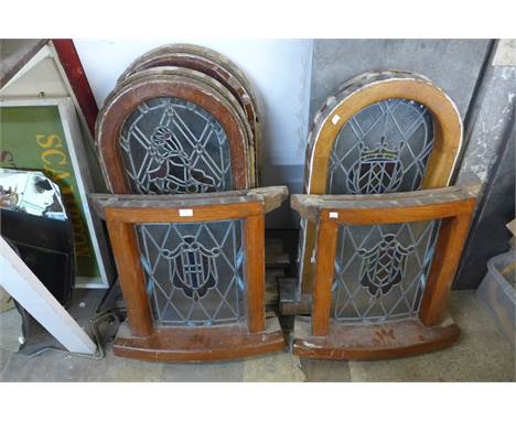 A set of three stained glass windows and another pair of stained glass windows