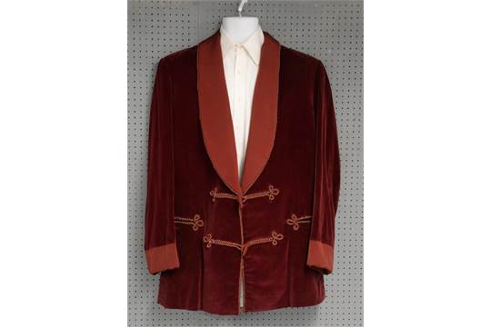 A Burgundy Coloured Velvet Smoking Jacket Worn By Sir Christopher