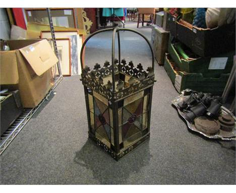 A brass framed hall lantern with leaded and stained glass panels, one cracked