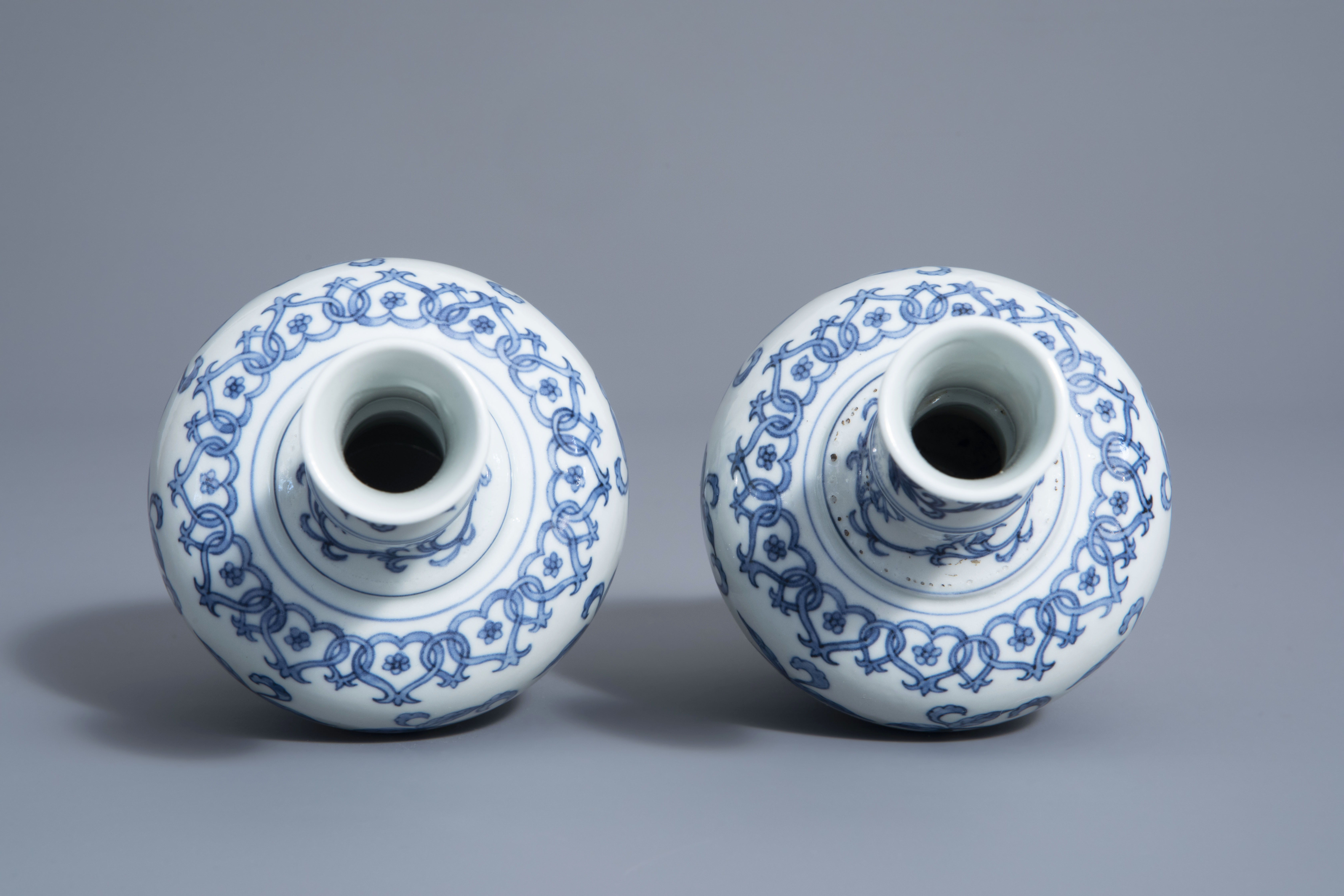 A pair of Chinese blue and white vases with floral design, Chenghua mark, 19th/20th C. - Image 5 of 6