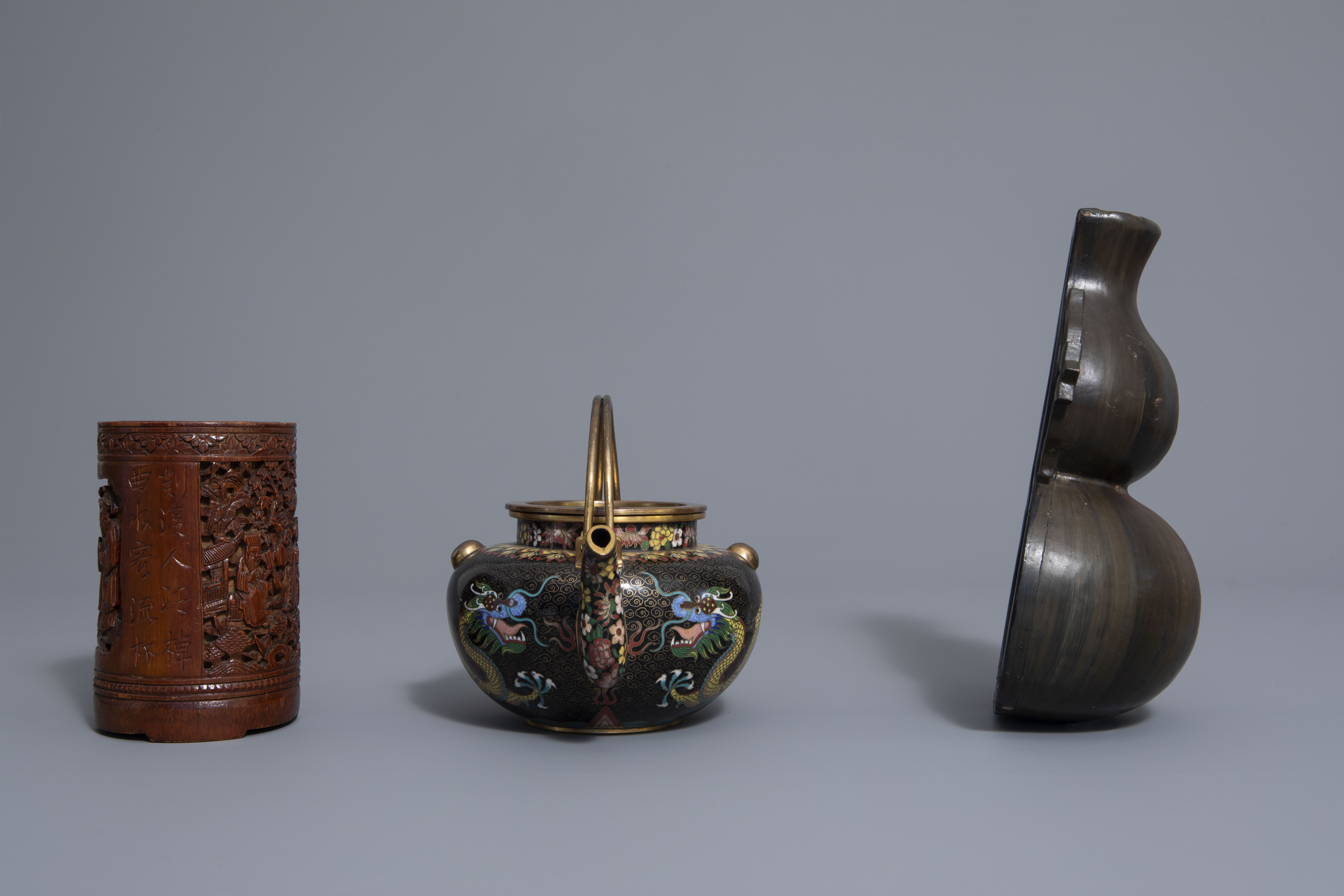 A Chinese tea block, cloisonné teapot, wall vase, bamboo brush pot & 3 red lacquer vases, 20th C. - Image 13 of 16