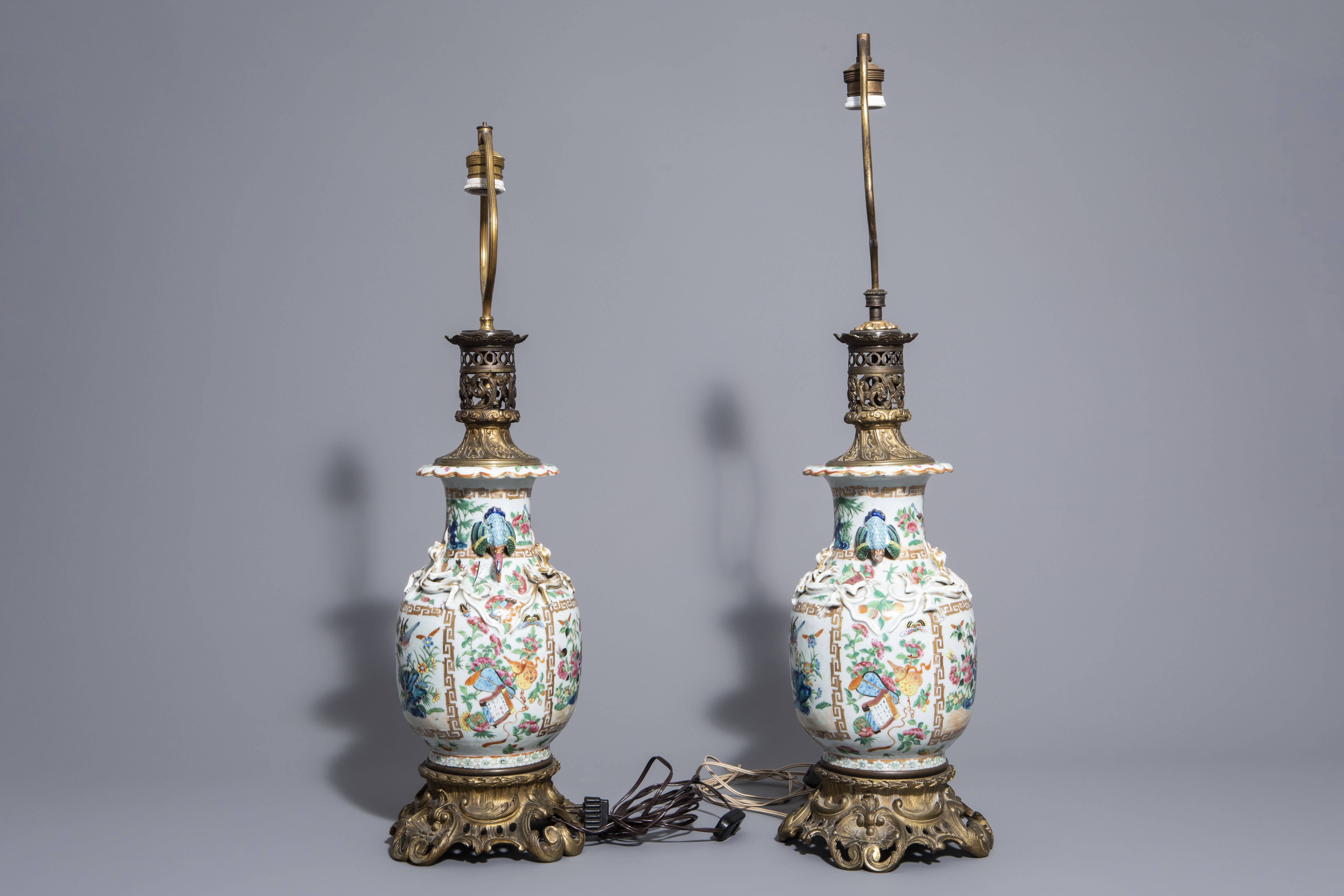 A pair of Chinese Canton famille rose vases mounted as lamps and a famille verte jar, 19th C. - Image 3 of 13