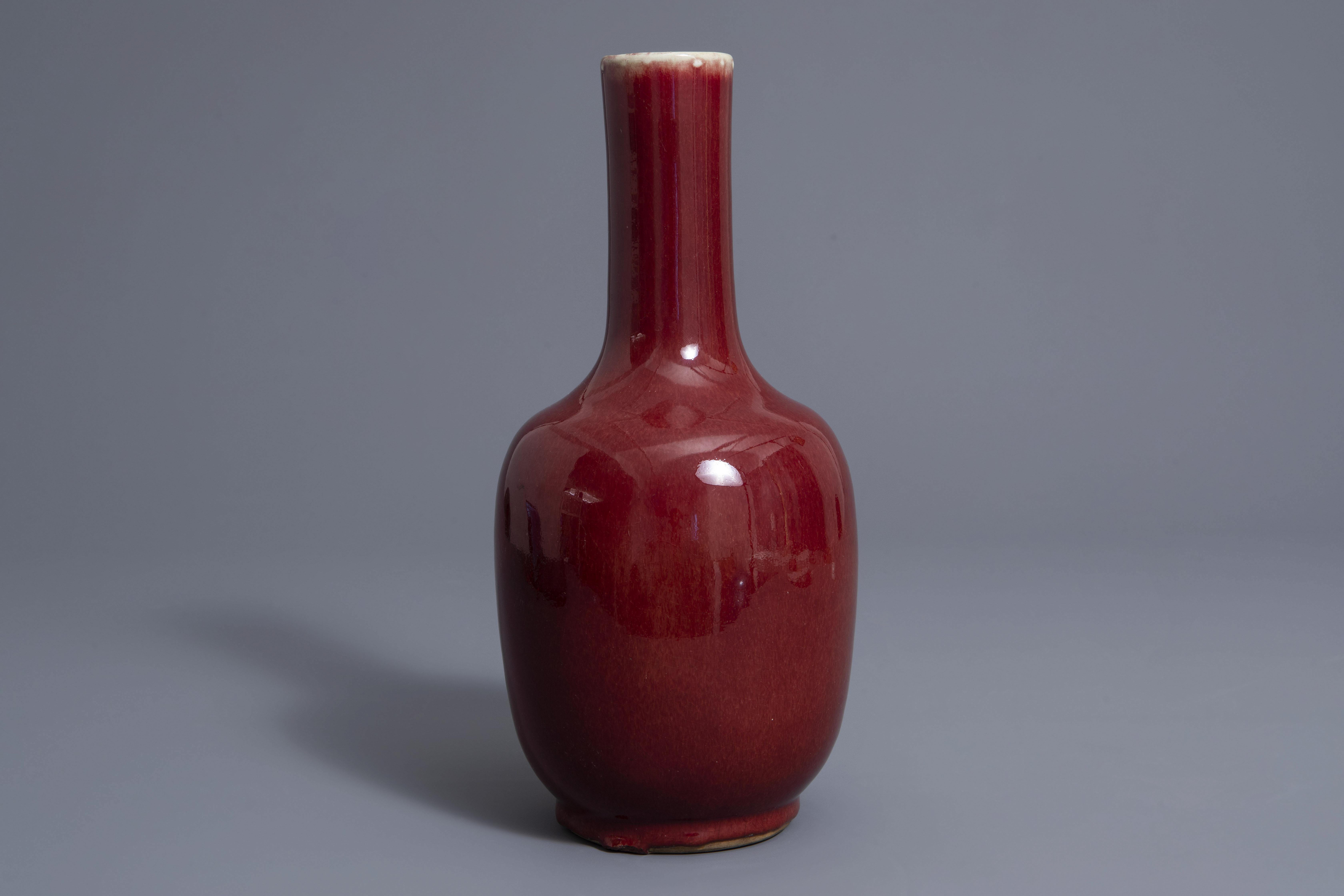 A Chinese sang de boeuf glazed bottle vase, Kangxi mark, 19th C. - Image 2 of 7