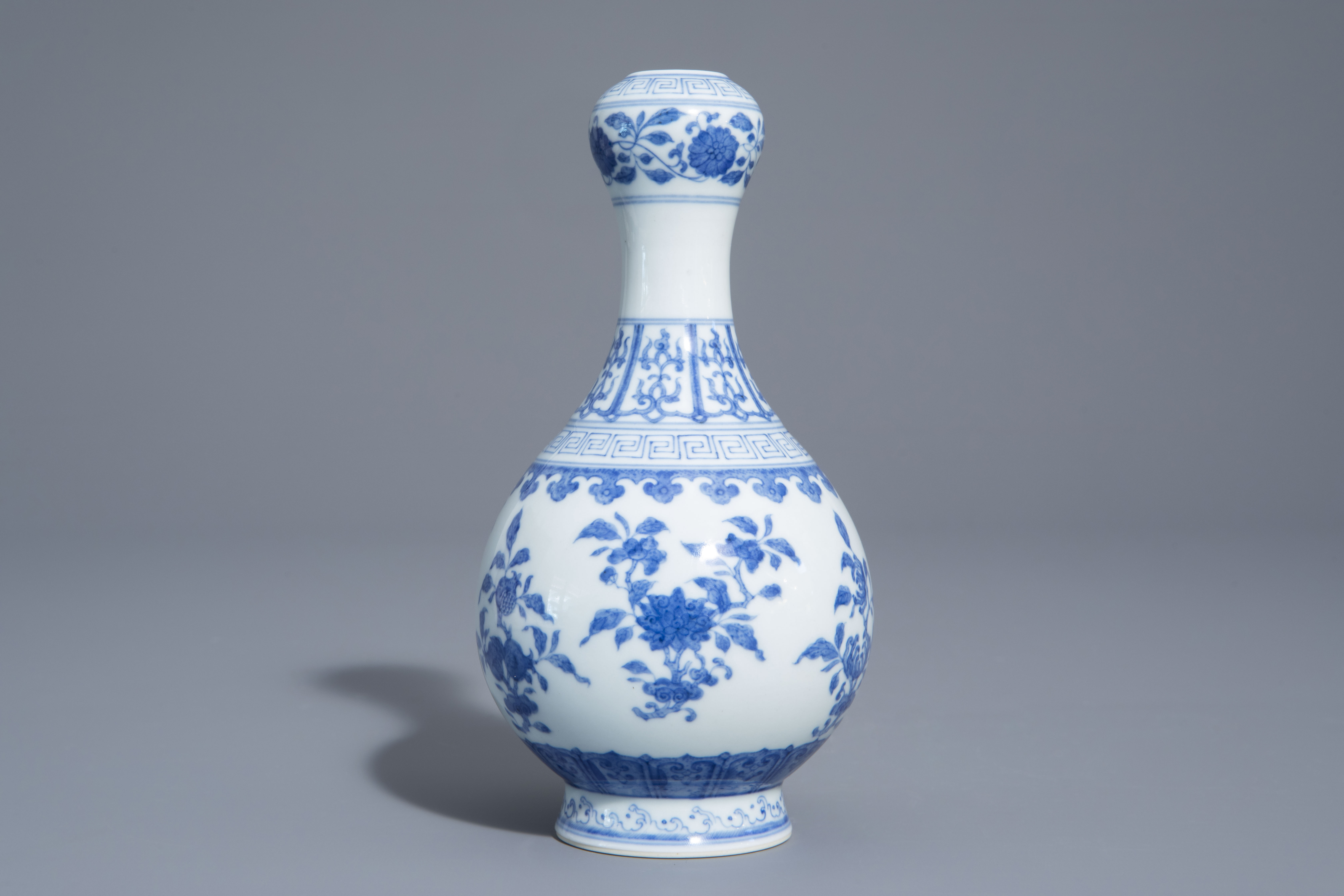 A Chinese blue and white garlic-head mouth vase with floral design, Qianlong mark, 20th C. - Image 2 of 7