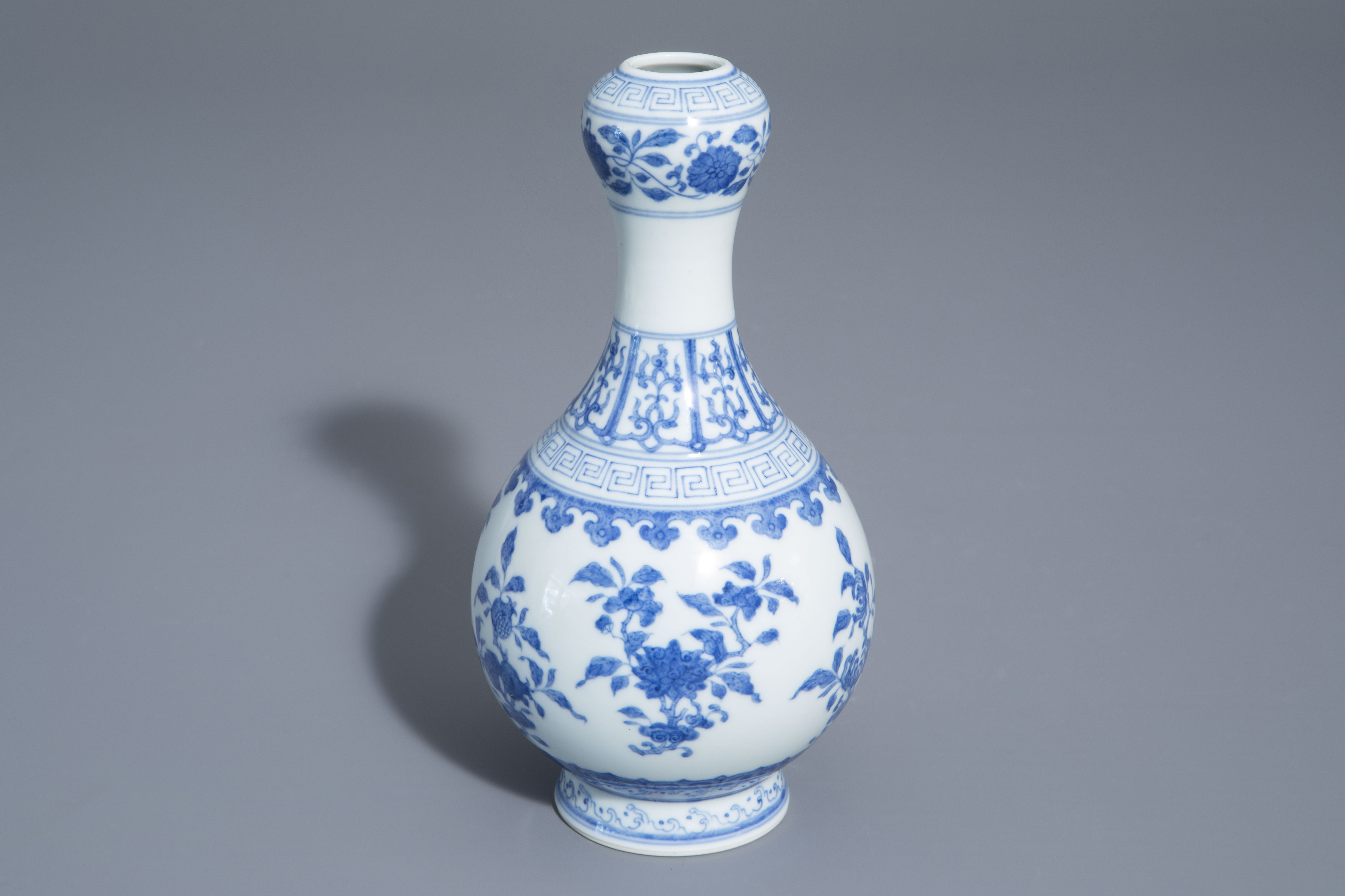 A Chinese blue and white garlic-head mouth vase with floral design, Qianlong mark, 20th C.