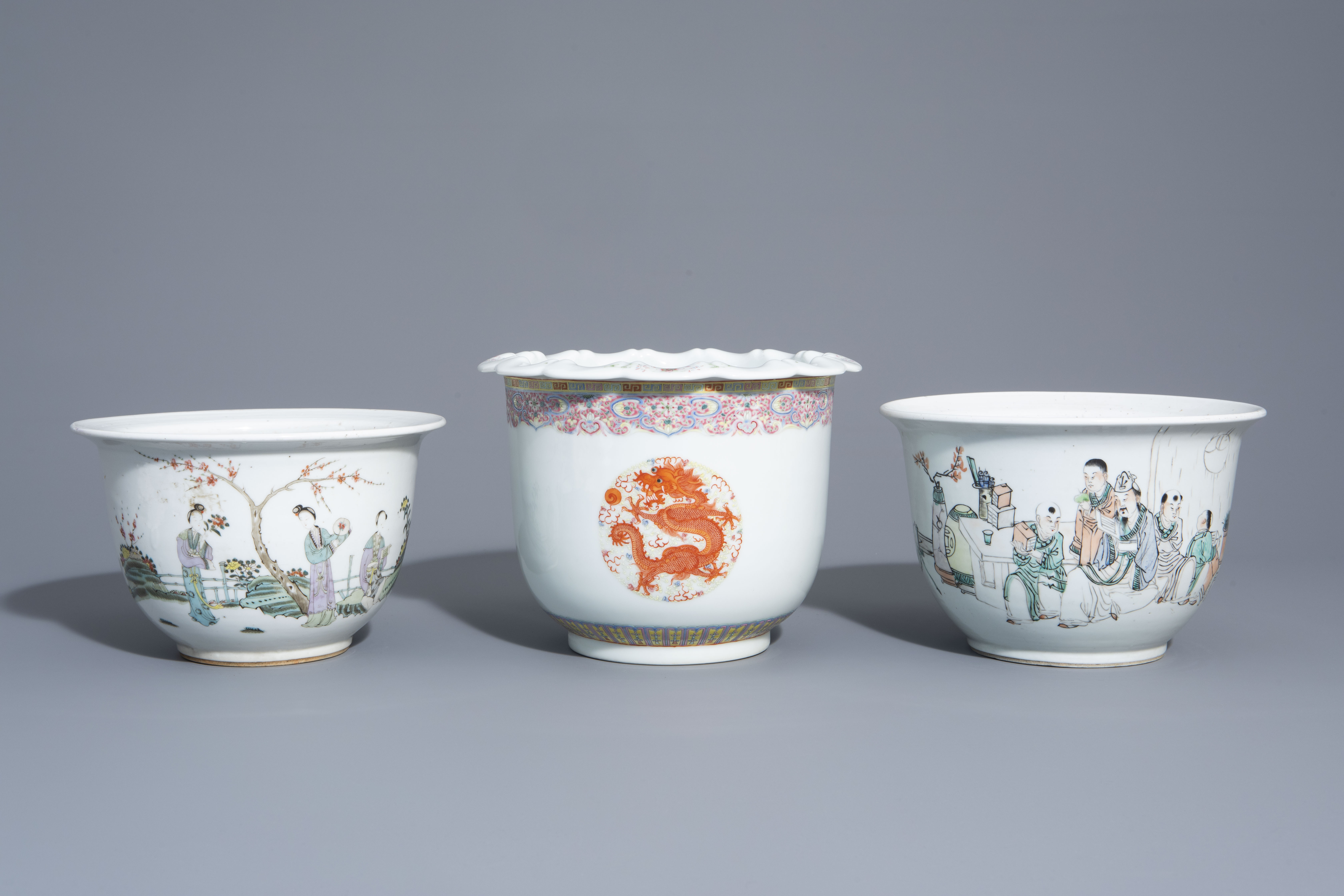 Three Chinese famille rose and qianjiang cai jardinires with different designs, 19th/20th C.