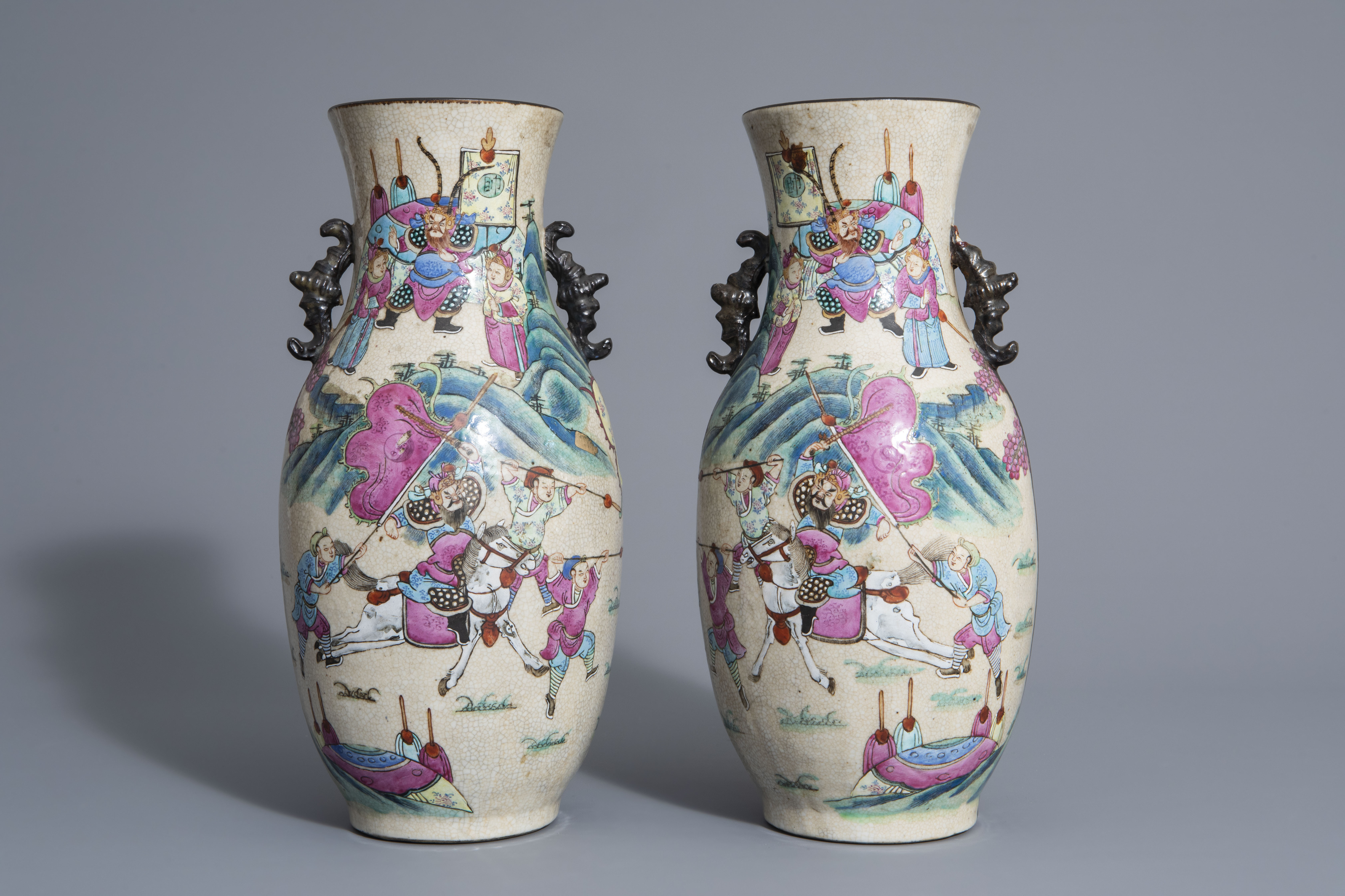 A pair of Chinese Nanking crackle glazed famille rose vases w. warrior scenes on stands, 19th C. - Image 4 of 7