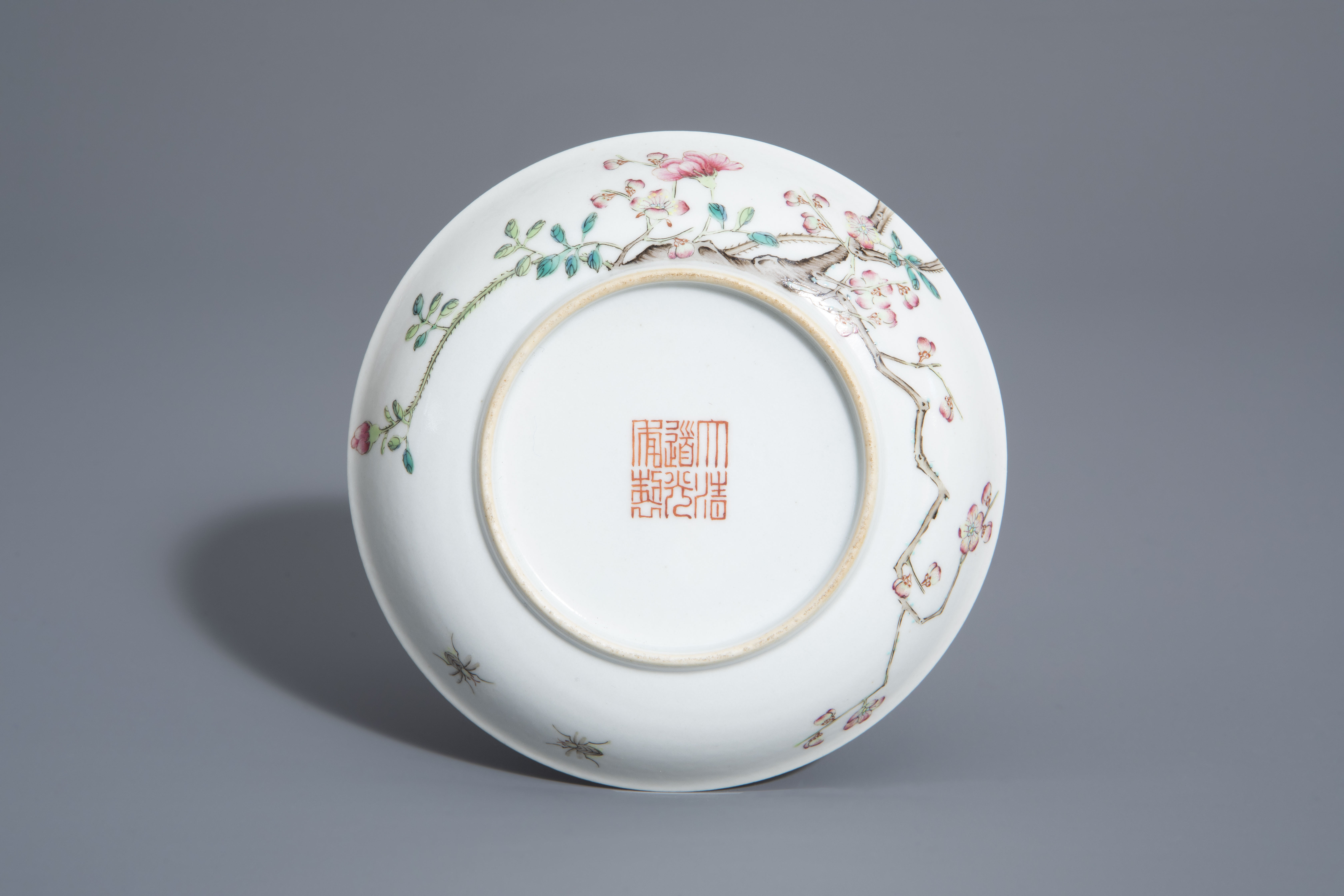 A Chinese famille rose cup and a saucer with different designs, 19th/20th C. - Image 3 of 11