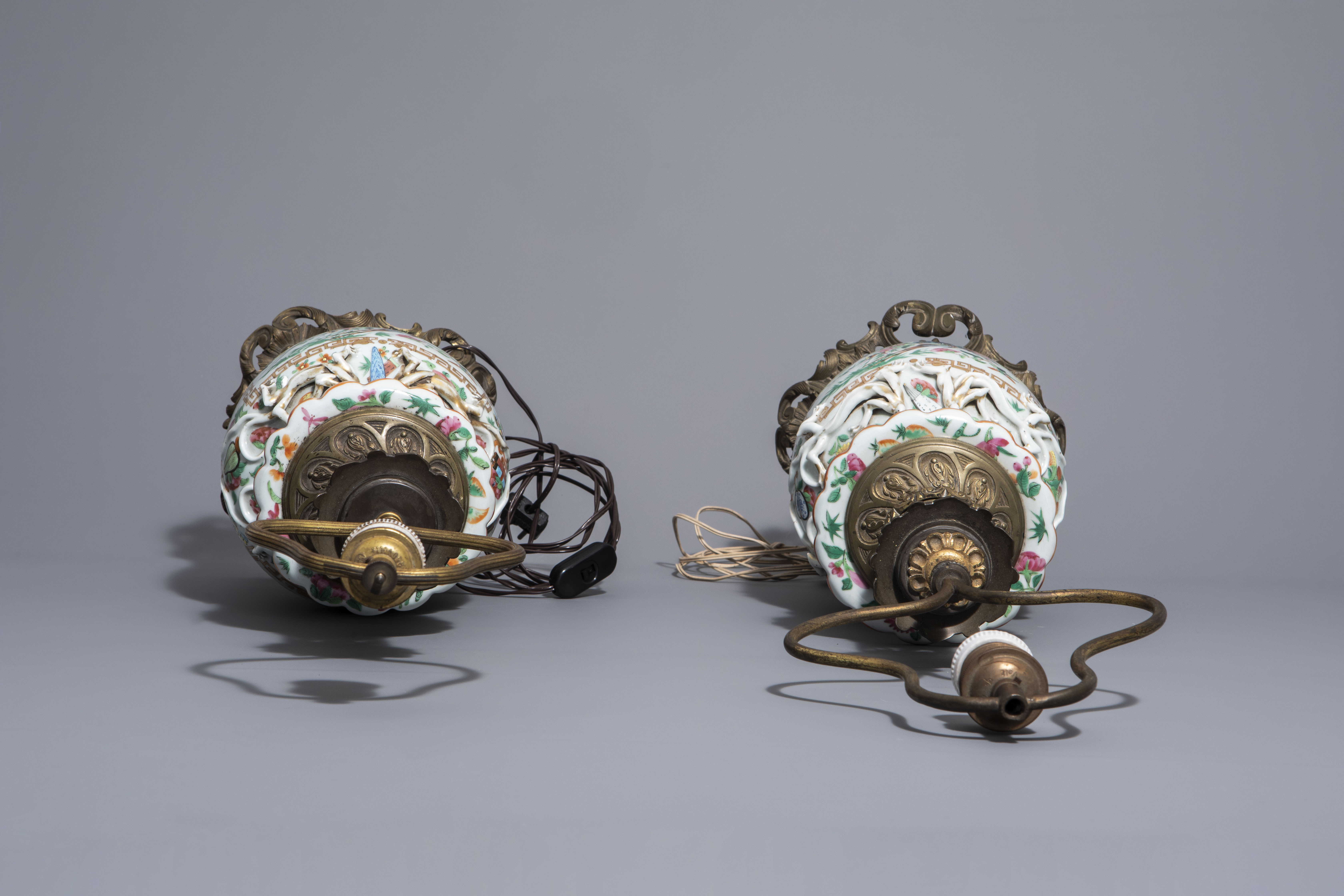 A pair of Chinese Canton famille rose vases mounted as lamps and a famille verte jar, 19th C. - Image 6 of 13